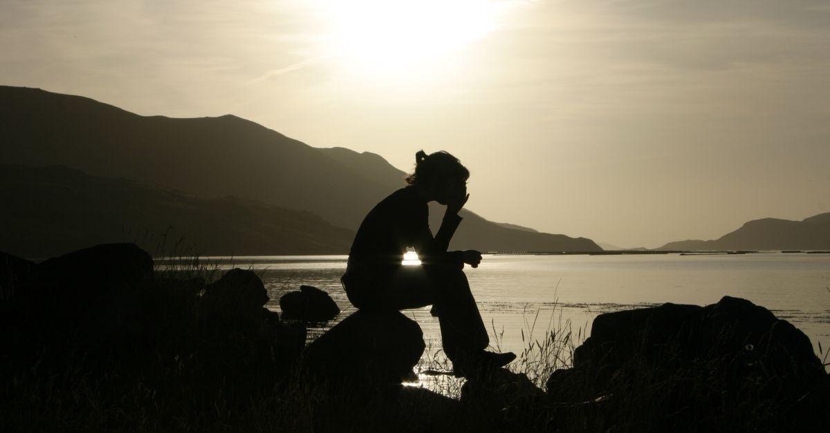 14458-woman-praying-lake-water-sun-light-silhouette-wide-1200w-tn